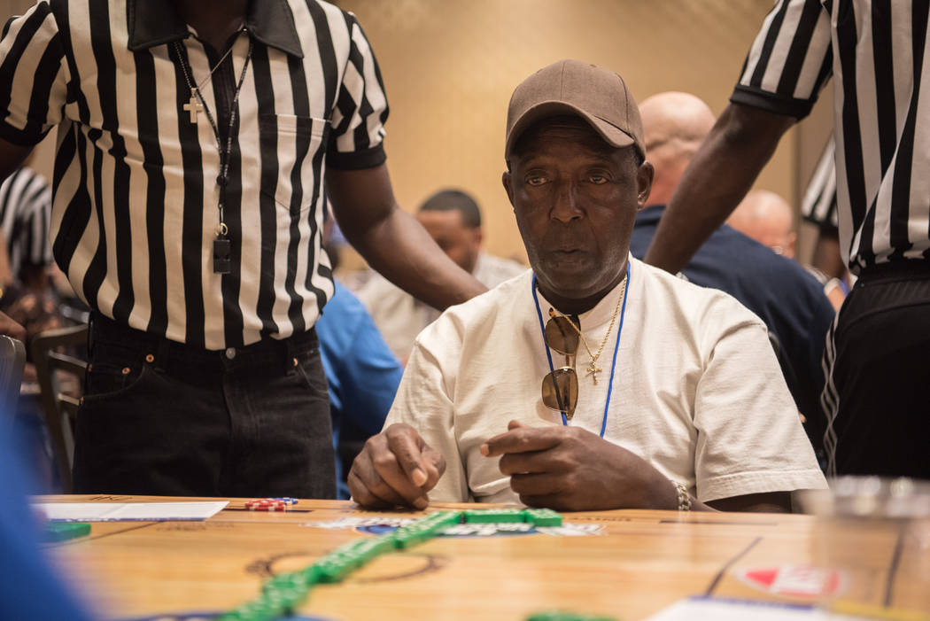 John Brown finishes a game in the first round at the Summer Slam Domino Tournament hosted by the The Universal Domino League at Westgate hotel-casino on Saturday, July 8, 2017, in Las Vegas. Morga ...