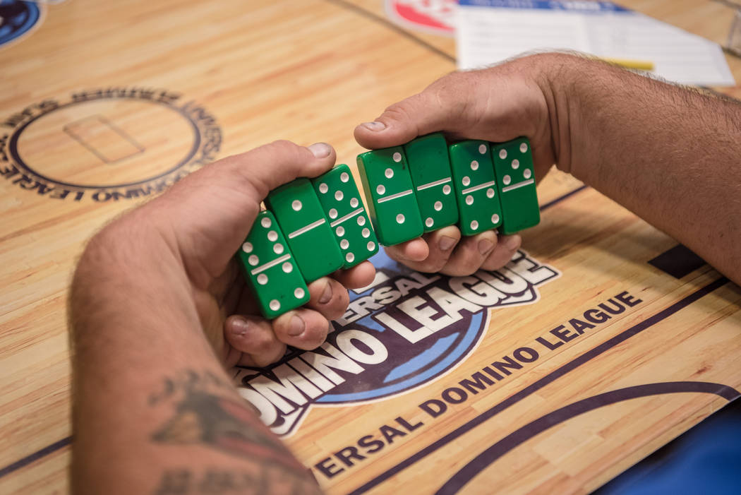 Jared Roberts takes a look at his choice of dominoes at the Summer Slam Domino Tournament hosted by the The Universal Domino League at Westgate hotel-casino on Saturday, July 8, 2017, in Las Vegas ...