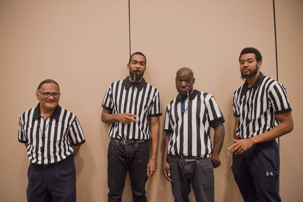 Referrees Don Smiler, left, Devon Neal, Arlin Dwayne Jr. Carroll, and Antonio Neal pose for a portrait at the Summer Slam Domino Tournament hosted by the The Universal Domino League at Westgate ho ...