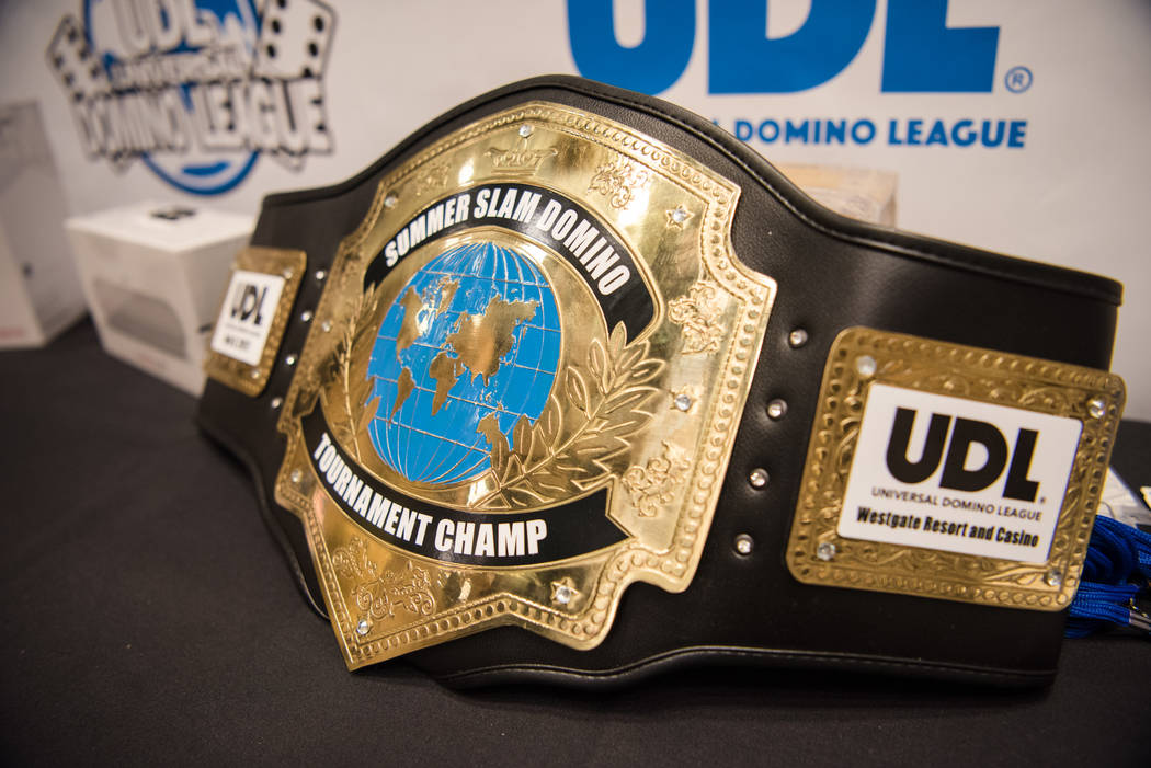 The championship belt sits on the main stage table at the Summer Slam Domino Tournament hosted by the The Universal Domino League at Westgate hotel-casino on Saturday, July 8, 2017, in Las Vegas.  ...