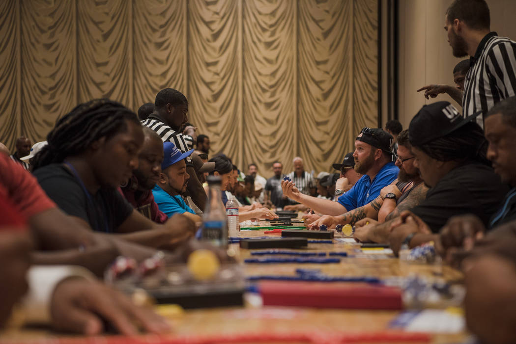 Jared Roberts shows a referee his domino at the The Summer Slam Domino Tournament hosted by the The Universal Domino League at Westgate hotel-casino on Saturday, July 8, 2017, in Las Vegas. Morgan ...