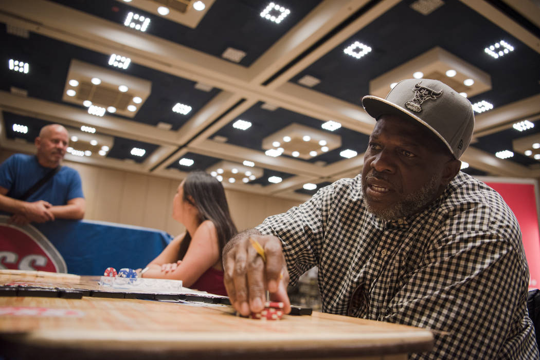 Gary Jackson practices his domino skills at the Summer Slam Domino Tournament hosted by the The Universal Domino League at Westgate hotel-casino on Saturday, July 8, 2017, in Las Vegas. Morgan Lie ...
