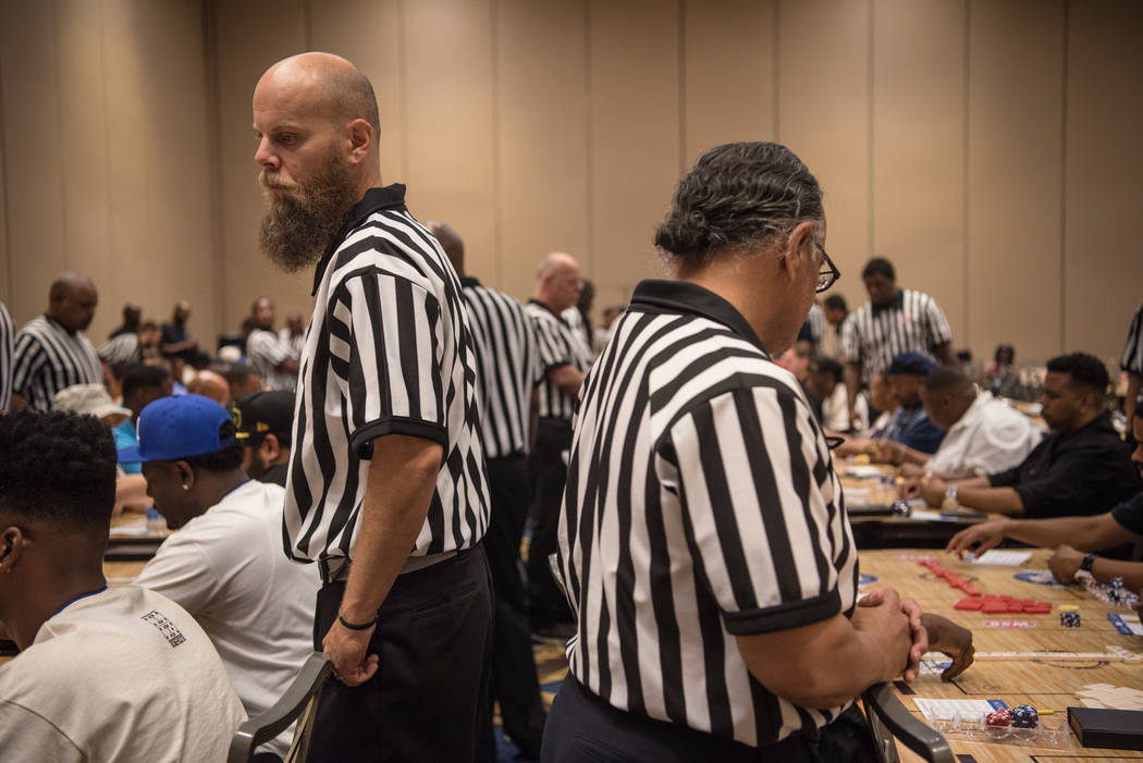 Nick Theodore referees multiple games of dominoes at the Summer Slam Domino Tournament hosted by the The Universal Domino League at Westgate hotel-casino on Saturday, July 8, 2017, in Las Vegas. M ...
