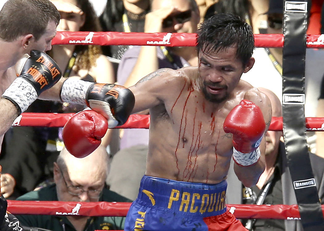 Manny Pacquiao, right, of the Philippines and Jeff Horn, left, of Australia fight during their WBO World welterweight title bout in Brisbane, Australia, Sunday, July 2, 2017. (AP Photo/Tertius Pic ...