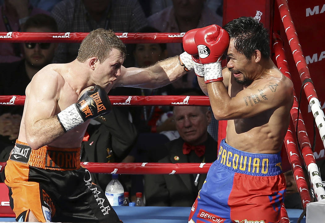 Jeff Horn of Australia, left, lands a left to Manny Pacquiao of the Philippines during their WBO World Welterweight title fight in Brisbane, Australia, Sunday, July 2, 2017. (AP Photo/Tertius Pickard)