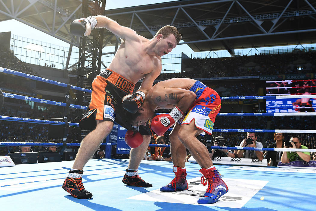 Manny Pacquiao of the Philippines and Jeff Horn of Australia fight.  (AAP/Dave Hunt/via Reuters)