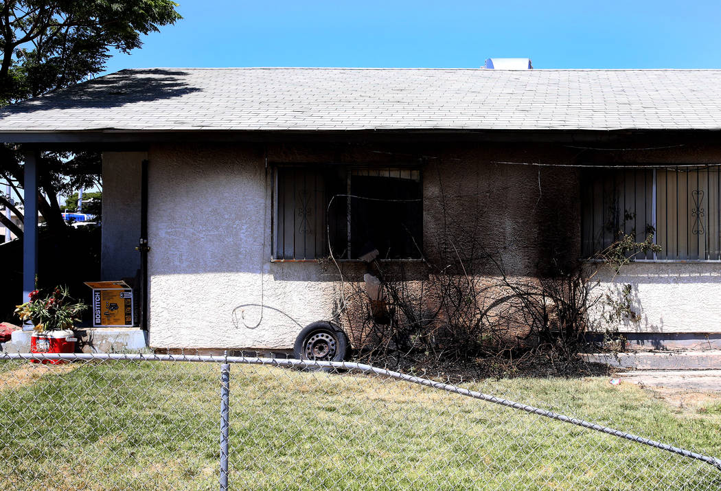 Marks from a fire on the home at 602 Madison Drive on Monday, July 3, 2017. A family of four have been displaced after the Sunday night fire, caused by illegal fireworks, spread from a burning bus ...
