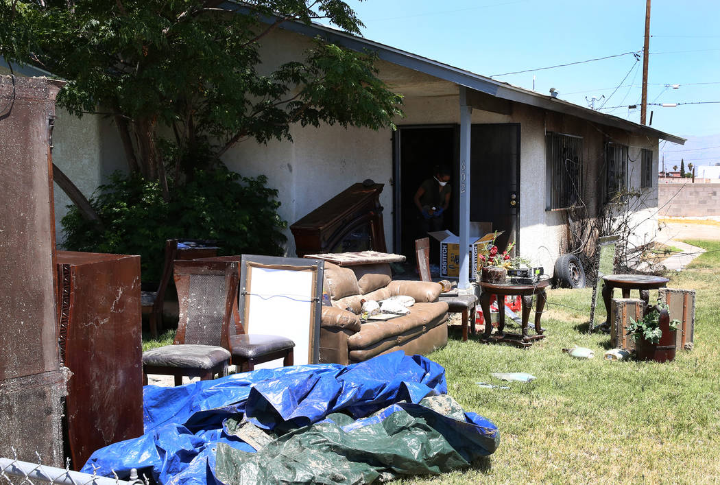 Fire-damaged furniture sits outside the home at 602 Madison Drive on Monday, July 3, 2017. A family of four have been displaced after the Sunday night fire, caused by illegal fireworks, spread fro ...
