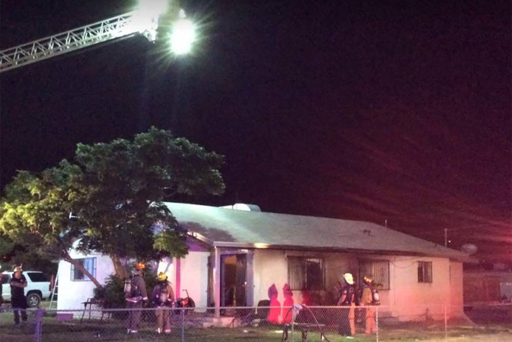 A family of four has been displaced from their home at 602 Madison Drive after a Sunday fire spread from a burning bush to their home. Firefighters believe the fire was a result of fireworks. (Tim ...