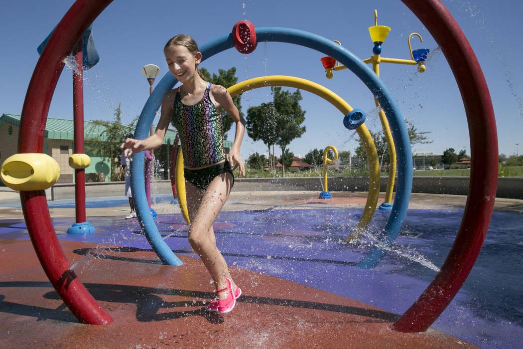 Abigal Hoguin, 11, of North Las Vegas, runs through the waterpark in Centennial Hills Park in northwest Las Vegas, Thursday, June 15, 2017. (Gabriella Angotti-Jones/Las Vegas Review-Journal) @gabr ...
