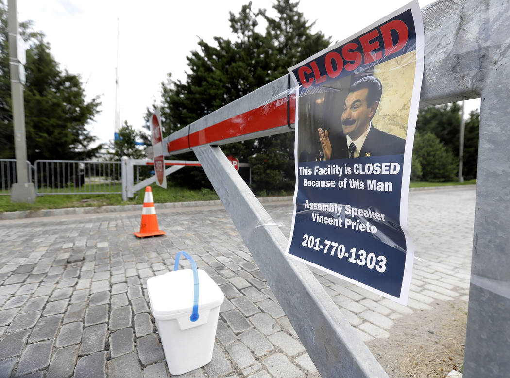 A sign hangs from a barricade at the entrance to Liberty State Park, which remains closed due to the New Jersey government shutdown, Saturday, July 1, 2017, in Jersey City., N.J. Gov. Chris Christ ...