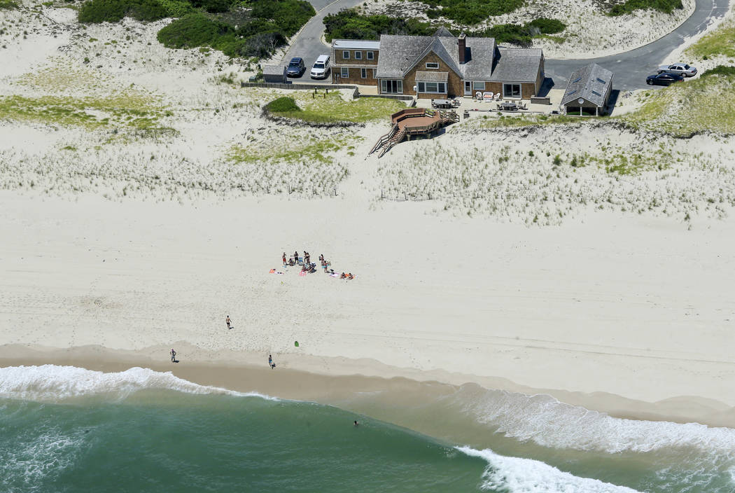 In this Sunday, July 2, 2017, photo, New Jersey Gov. Chris Christie uses the beach with his family and friends at the governor's summer house at Island Beach State Park in New Jersey. Christie is  ...