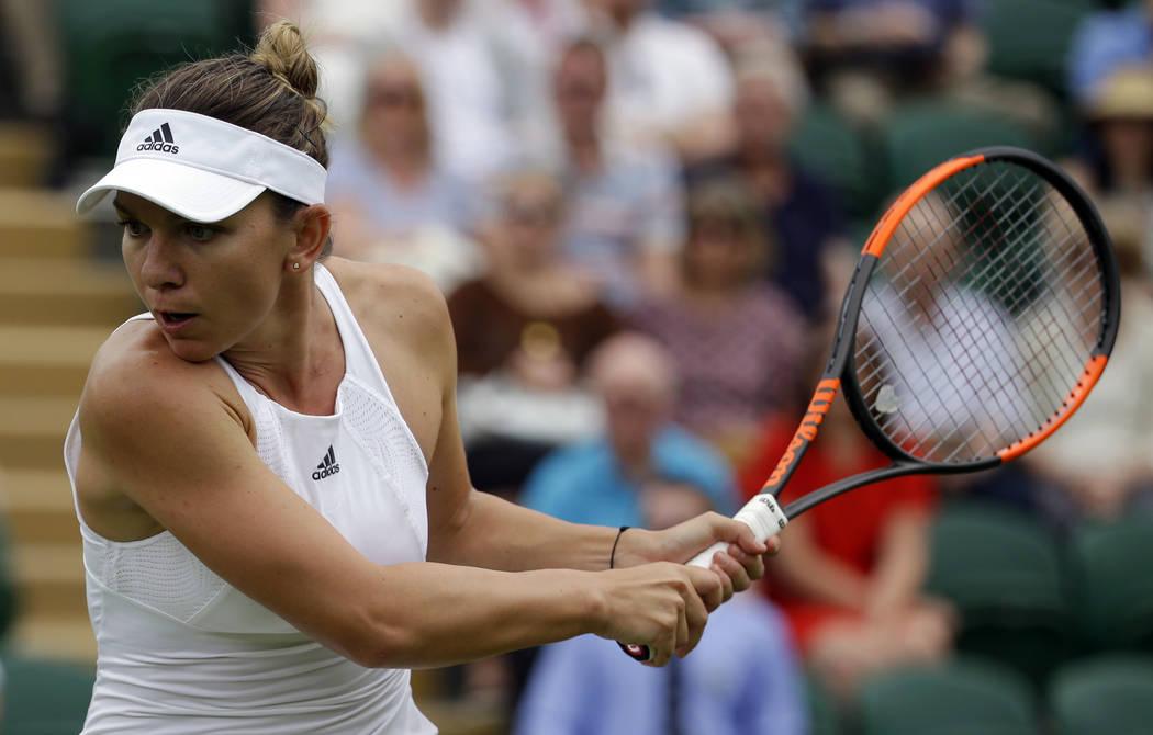 Romania's Simona Halep returns to New Zealand's Marina Erakovic during their Women's Singles Match on day one at the Wimbledon Tennis Championships in London Monday, July 3, 2017. (AP Photo/Alasta ...