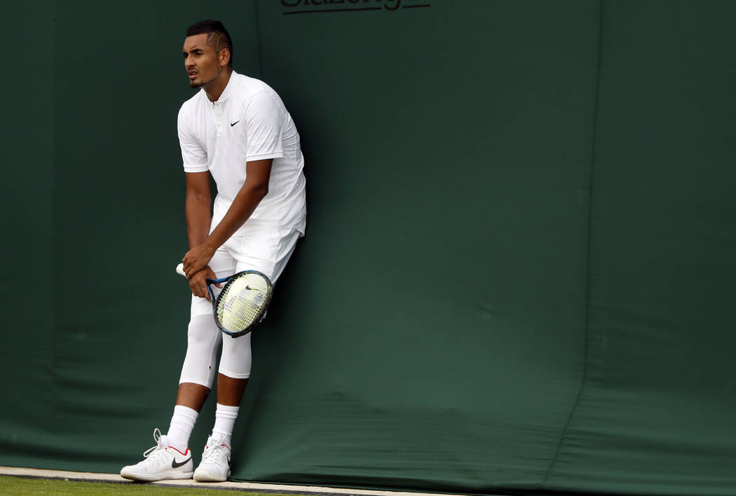 Australia's Nick Kyrgios rests during his Men's Singles Match against Pierre-Hugues Herbert of France, on the opening day at the Wimbledon Tennis Championships in London Monday, July 3, 2017. (AP  ...