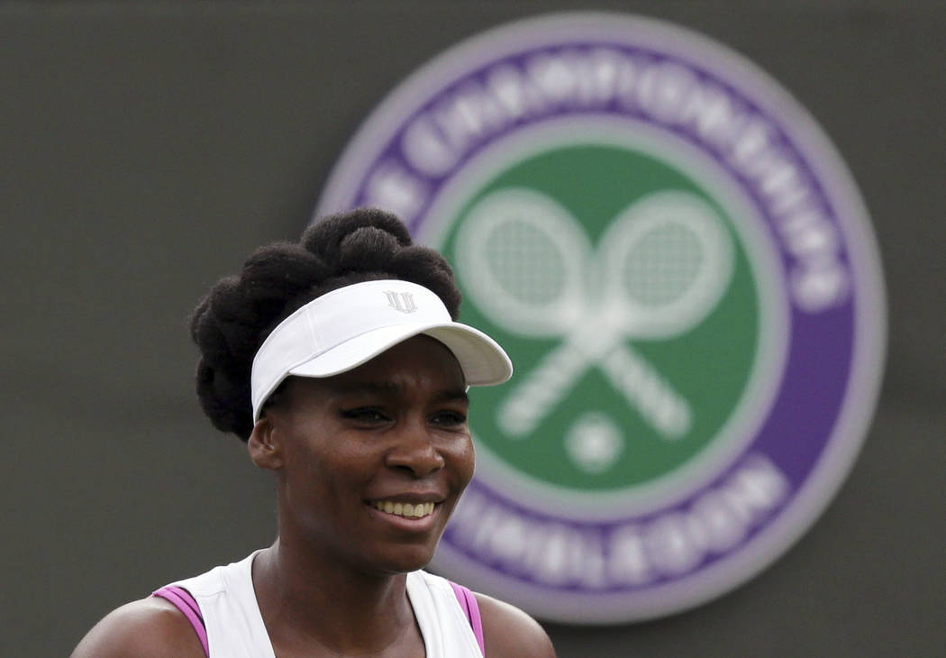 Venus Williams of the United States looks on during her Women's Singles Match against Belgium's Elise Mertens on the opening day at the Wimbledon Tennis Championships in London Monday, July 3, 201 ...