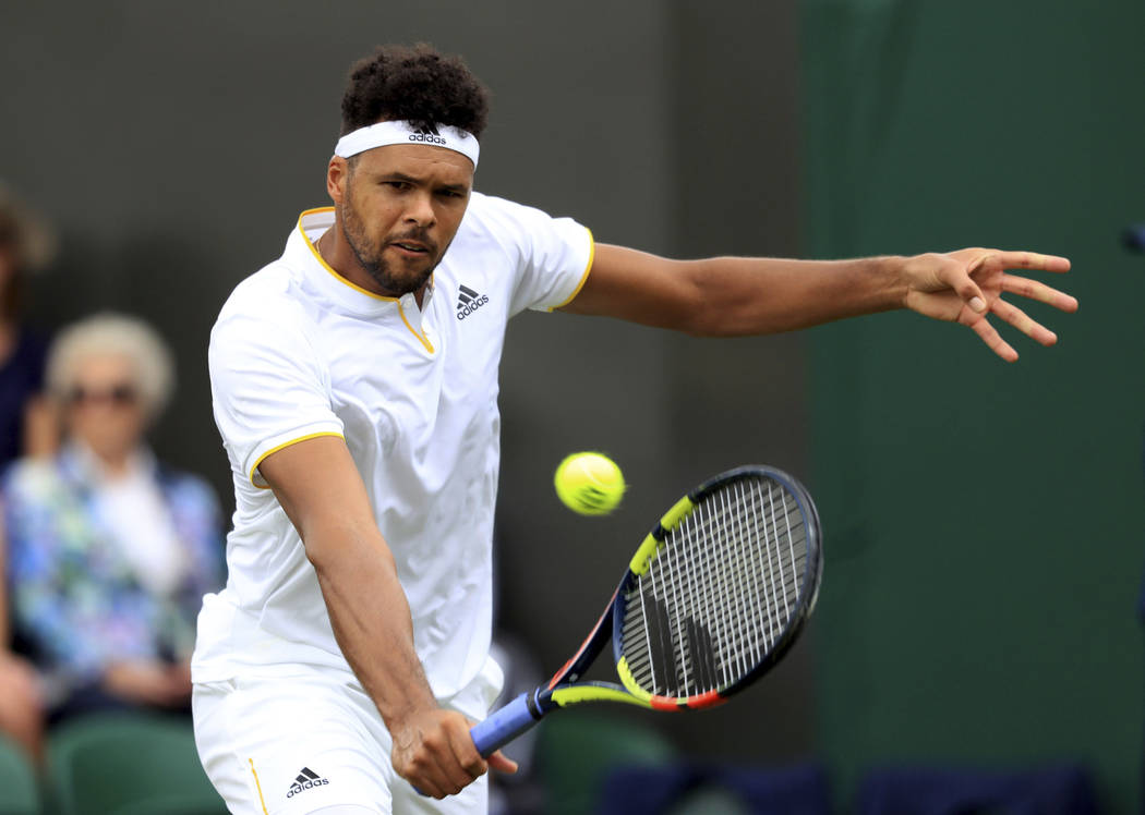 France's Jo-Wilfried Tsonga in action against Britain's Cameron Norrie on day one of the Wimbledon tennis Championships at The All England Lawn Tennis and Croquet Club, Wimbledon, London, Monday,  ...
