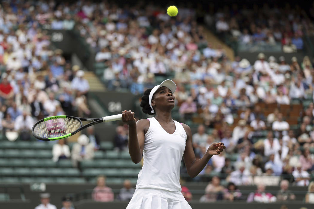 Venus Williams of the United States returns to Belgium's Elise Mertens during their Women's Singles Match on the opening day at the Wimbledon Tennis Championships in London Monday, July 3, 2017. ( ...