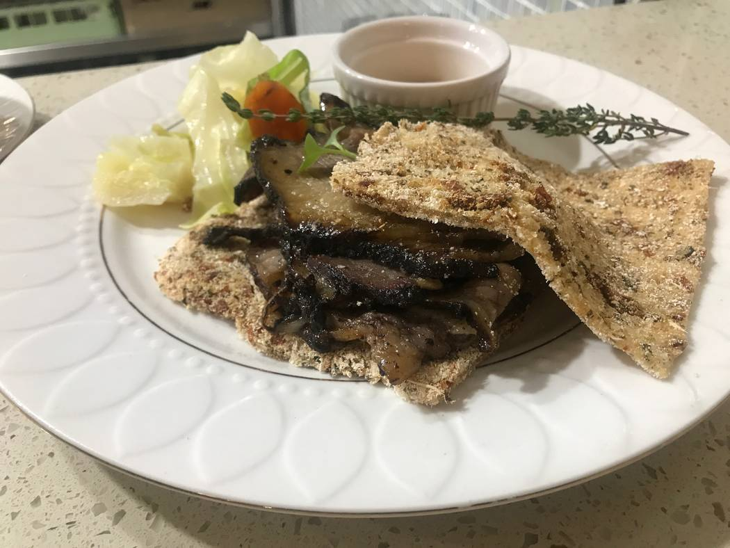 The smoked jerk brisket sandwich is served with a side on June 30 at the House of Manchester Caribbean Grill is located at 2256 Losee Road, Suite E. (Kailyn Brown/View) @KailynHype