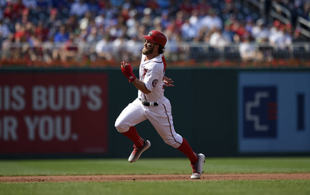 Washington Nationals' Bryce Harper runs towards third during a baseball game against the Chicago Cubs, Thursday, June 29, 2017, in Washington. (AP Photo/Nick Wass)
