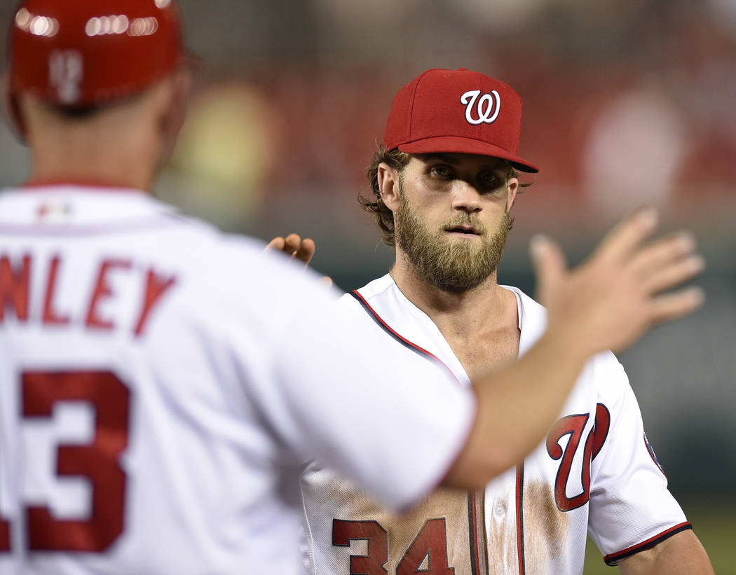 Washington Nationals' Bryce Harper celebrates 8-4 win over the Chicago Cubs after a baseball game, Wednesday, June 28, 2017, in Washington. (AP Photo/Nick Wass)