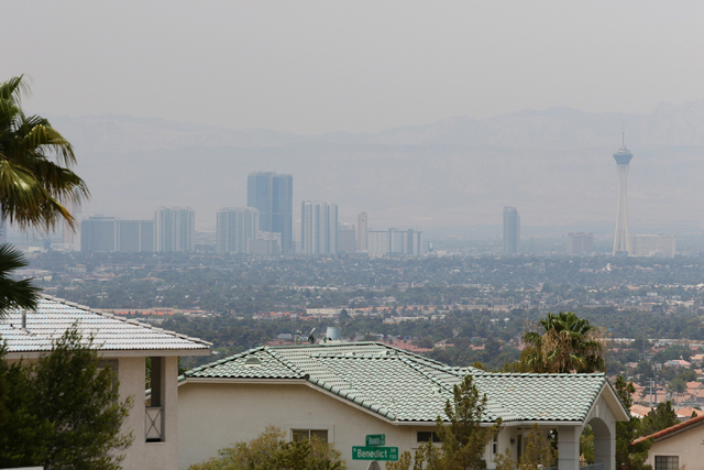 Haze is seen from the base of Frenchman Mountain covering the valley and downtown Las Vegas Friday, June 26, 2015. The Clark County Air Quality Department issued an advisory Monday, July 3, 2017,  ...