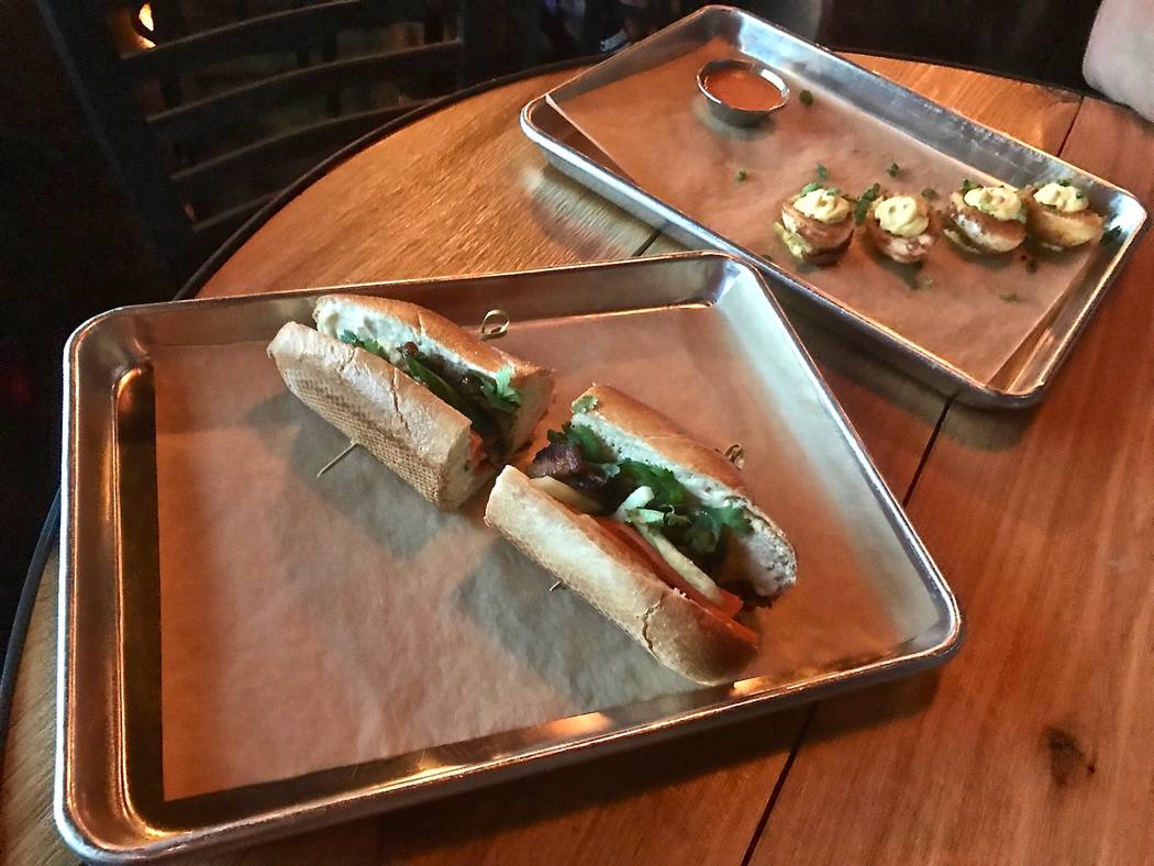 595 Craft and Kitchen offers several types of banh mi including its signature sandwich: (pictured) features honey soy glazed pork, cucumber, pickled daikon, carrot cilantro, jalapeño mayonnaise a ...