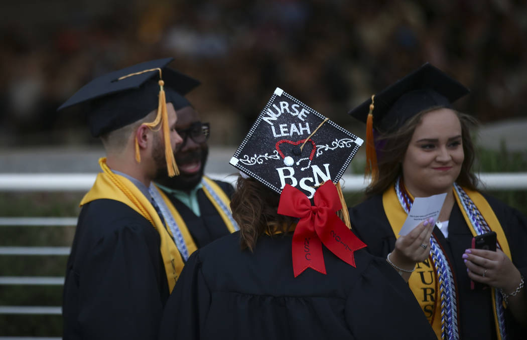 Graduating students make their way to their seats at the start of the Nevada State College commencement ceremony at the Henderson Pavilion on Friday, May 5, 2017. Over 400 degrees were expected to ...
