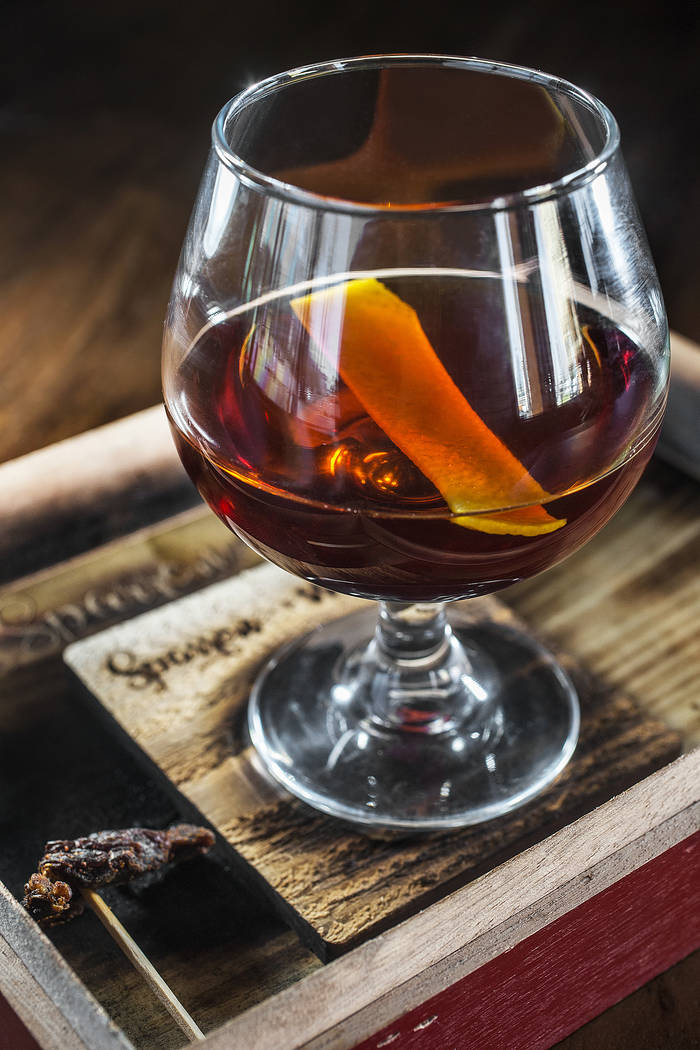 The Get Off My Lawn, with Camus VS cognac, amaro blend, maple syrup, cedar bitters and a side of beef jerky on Monday, July 3, 2017, at Sparrow + Wolf, in Las Vegas. Benjamin Hager Las Vegas Revie ...