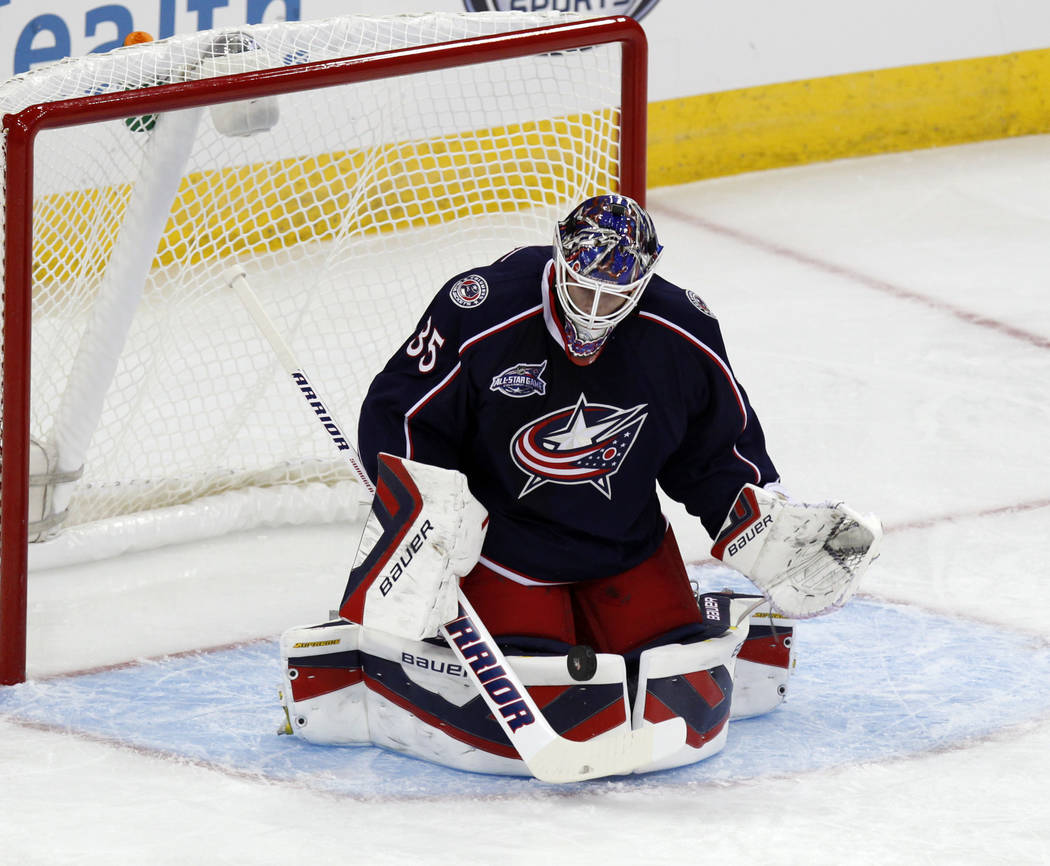 Columbus Blue Jackets' Oscar Dansk, of Sweden, stops a shot agains the St. Louis Blues during an NHL preseason hockey game in Columbus, Ohio, Sunday, Sept. 21, 2014. (AP Photo/Paul Vernon)