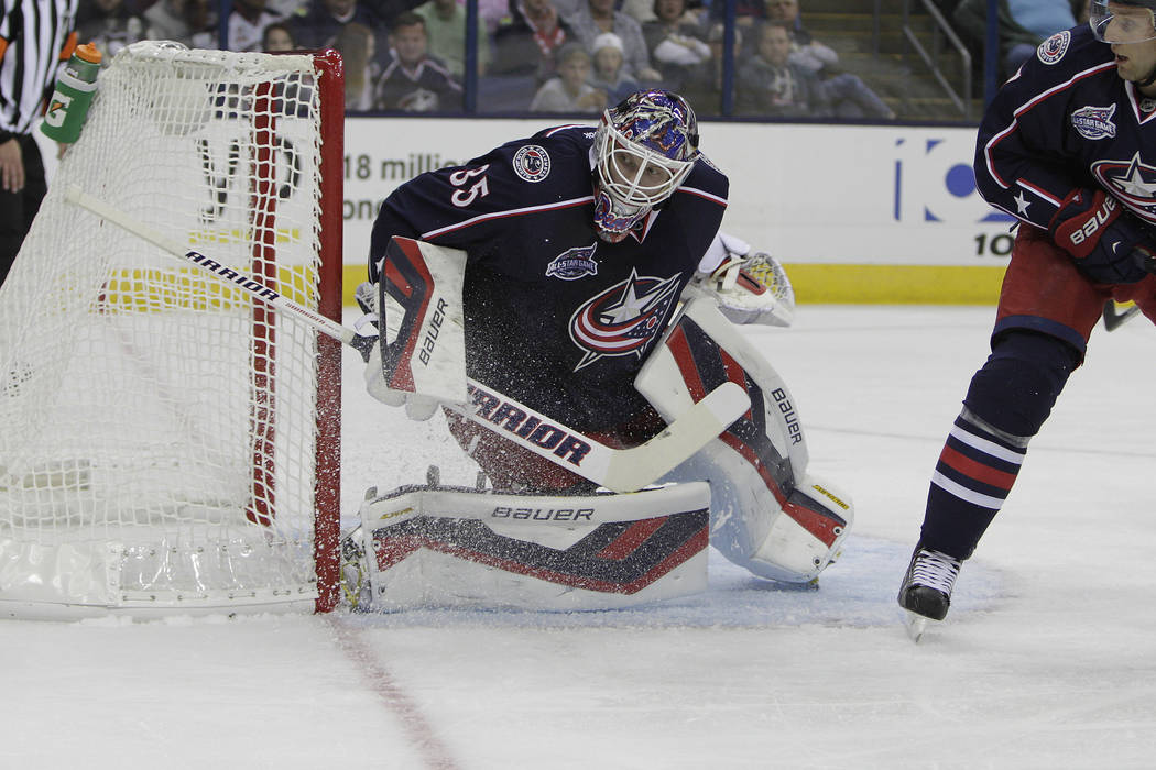 Columbus Blue Jackets' Oscar Dansk, of Sweden, plays against the Pittsburgh Penguins during an NHL preseason hockey game Tuesday, Sept. 23, 2014, in Columbus, Ohio. (AP Photo/Jay LaPrete)