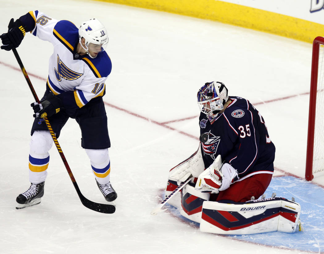 Columbus Blue Jackets goalie Oscar Dansk, right, of Sweden, stops a shot against St. Louis Blues' Jori Lehtera, of Finland, during an NHL preseason hockey game in Columbus, Ohio, Sunday, Sept. 21, ...