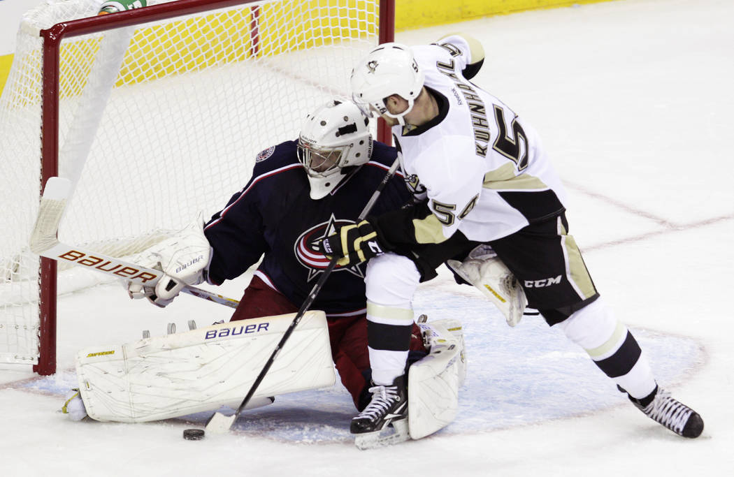 Columbus Blue Jackets' Oscar Dansk, left, of Sweden, makes a save against Pittsburgh Penguins' Tom Kuhnhacki, of Germany, during the third period of an NHL preseason hockey game, Sunday, Sept. 15, ...