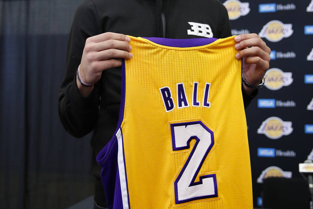 Los Angeles Lakers draft pick Lonzo Ball poses with his jersey after a news conference, Friday, June 23, 2017, in El Segundo, Calif. (AP Photo/Jae C. Hong)