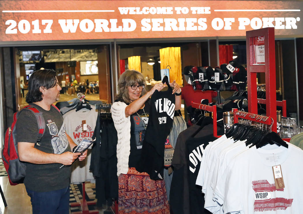 A couple, who declined to give their names, shop for 2017 World Series of Poker T-shirts at the Rio hotel-casino's gift shop on Friday, July 7, 2017, in Las Vegas. (Bizuayehu Tesfaye/Las Vegas R ...