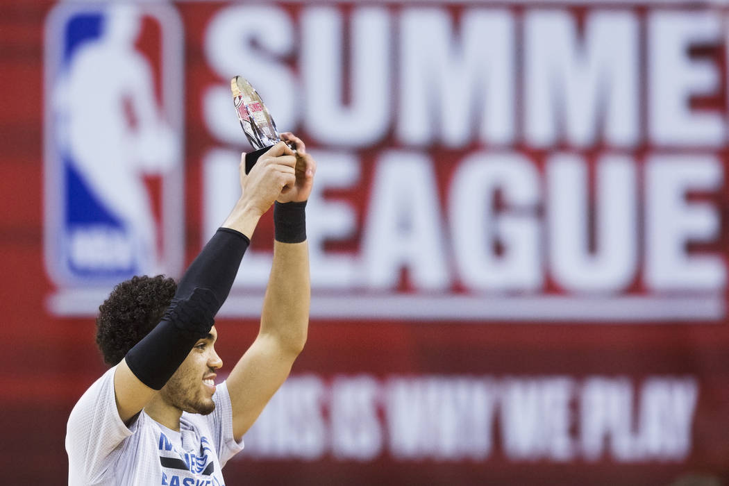 Minnesota Timberwolves guard Tyus Jones (1) raises the trophy for most valuable player of the NBA Summer League at Cox Pavilion at UNLV on Monday, July 18, 2016, in Las Vegas. Benjamin Hager/Las V ...