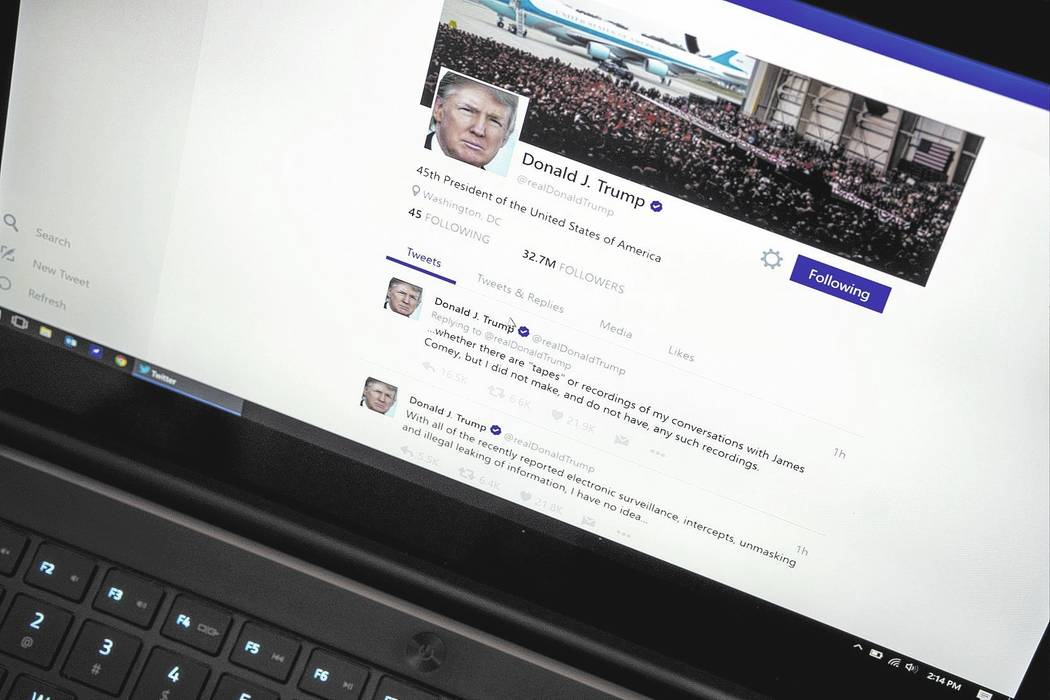President Donald Trump's Twitter page. (AP Photo/J. David Ake)