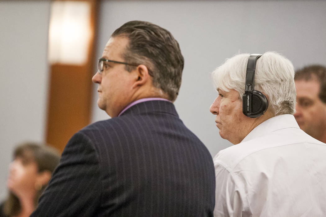 Thomas Randolph and his attorney, Clark Patrick, listen to jurors confirm their verdict after being sentenced to during the penalty phase of his murder trial at the Regional Justice Center in Las  ...