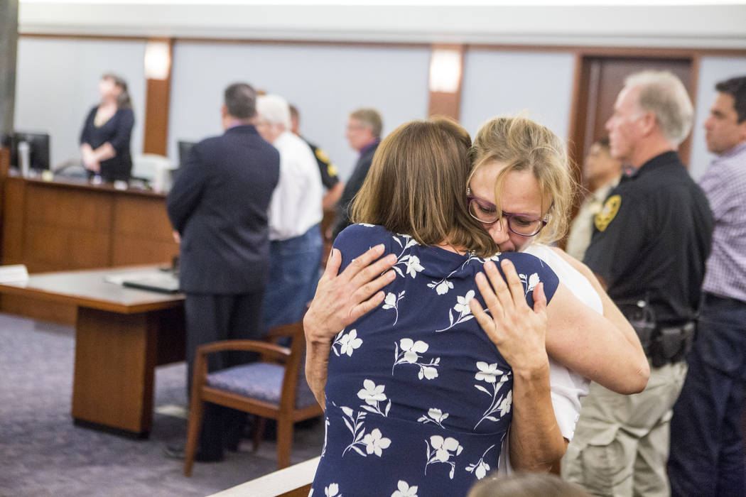 Colleen Beyer (in blue), the daughter of Sharon Randolph, is embraced after Thomas Randolph was sentenced to death by jurors during penalty phase of his murder trial at the Regional Justice Center ...