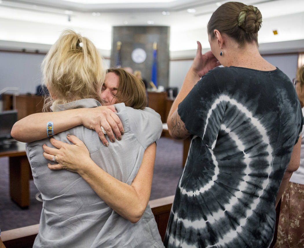 Colleen Beyer, center, the daughter of Sharon Randolph, is embraced after Thomas Randolph was sentenced to death by jurors during penalty phase of his murder trial at the Regional Justice Center i ...
