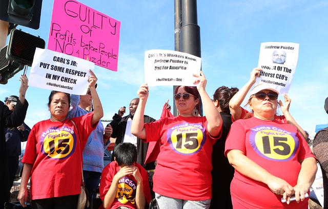 Petrade Santos, left, Irma Calzadillas and Bertha Nabarro joined other workers fighting for a minimum wage protest outside of a Carl's Jr. on 2100 Fremont St., Monday, Feb. 13, 2017, in Las Vegas. ...