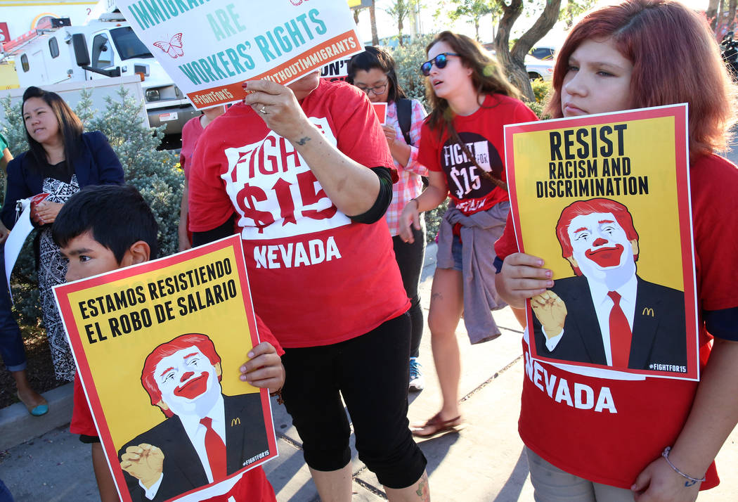 Angel Guzman, left, and his sister Zoe, 13, join McDonald's franchise employees to protest for a higher minimum wage outside of a McDonald's on 2650 W. Sahara Ave., on Wednesday, May 24, 2017, in  ...