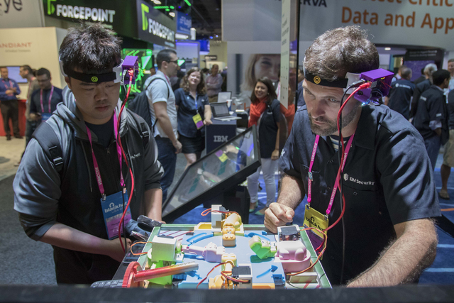 Show attendees use a mind sensor controlled game during the Black Hat convention at the Mandalay Bay convention center in Las Vegas on Thursday, Aug. 4, 2016. Richard Brian/Las Vegas Review-Journa ...