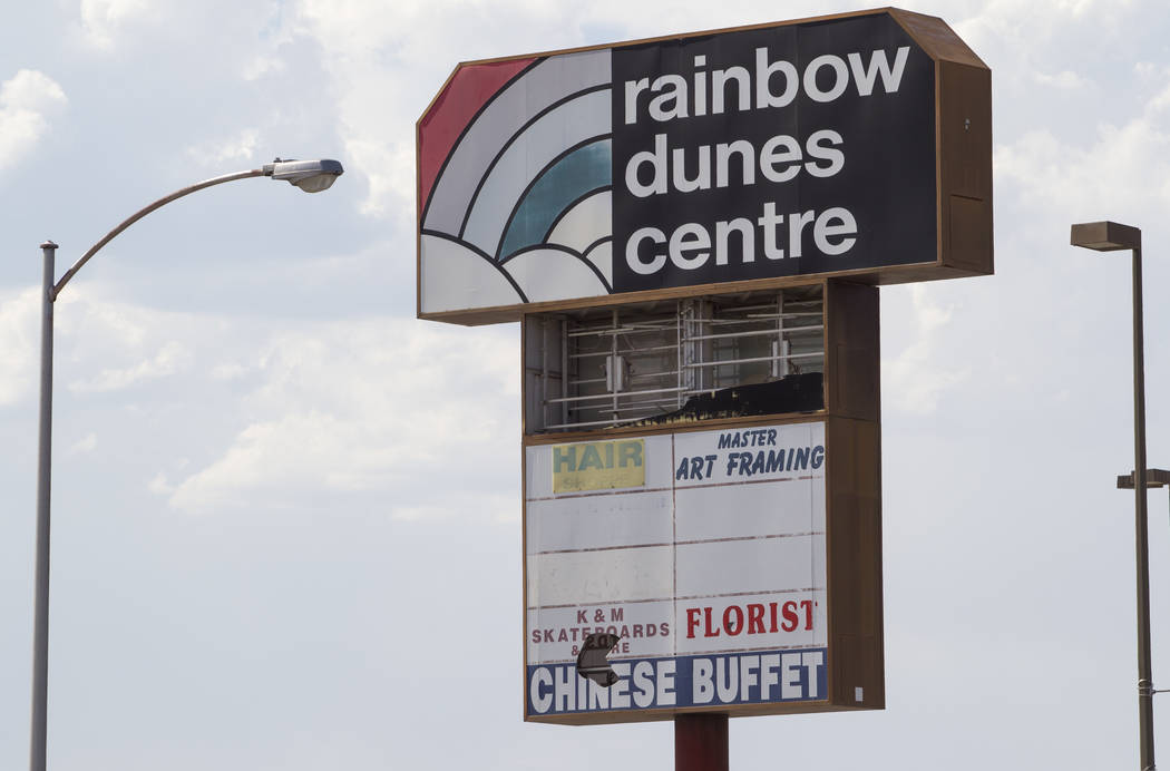 A battered sign shows past tenants of the Rainbow Dunes Centre located at the northwest corner of Rainbow Boulevard and Spring Mountain Road in Las Vegas, Thursday, July 6, 2017.  Richard Brian La ...