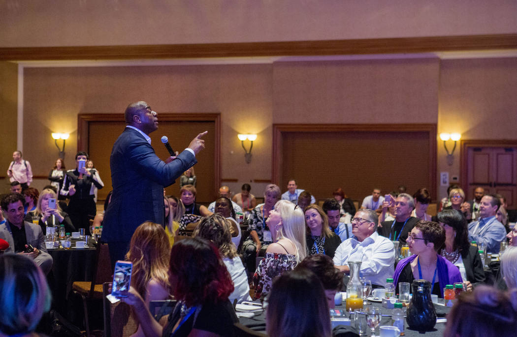 """Businessman and former basketball star Earvin """"Magic"""" Johnson delivers the keynote speech for the Professional Beauty Association Business Forum during Cosmoprof North America at ..."""