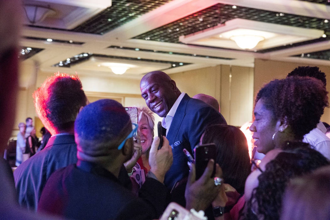 """Businessman and former basketball star Earvin """"Magic"""" Johnson meets attendees of the Professional Beauty Association Business Forum during Cosmoprof North America at Mandalay Bay ..."""