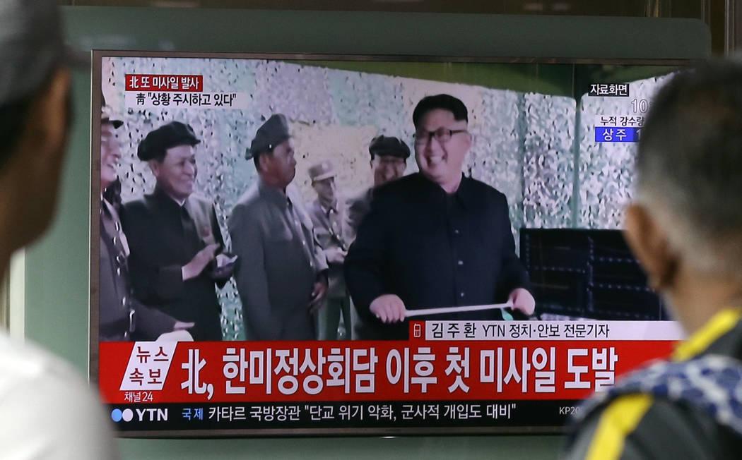 A TV news program shows a file image of North Korean leader Kim Jong Un, at Seoul Railway Station in Seoul, South Korea. in Seoul, South Korea, Tuesday, July 4, 2017. North Korea on Tuesday launch ...