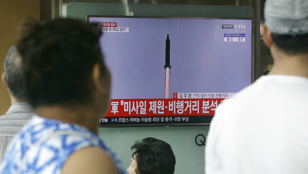 People watch a TV news program showing a file image of a missile being test-launched by North Korea, at the Seoul Railway Station in Seoul, South Korea, Tuesday, July 4, 2017. North Korea on Tuesd ...