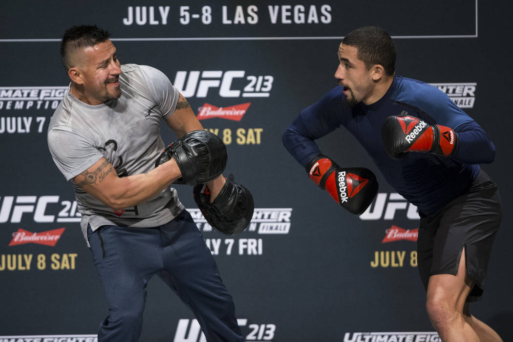 Robert Whittaker, right, during UFC open workouts at the Park Theater inside Monte Carlo hotel-casino in Las Vegas on Wednesday, July 5, 2017. Erik Verduzco Las Vegas Review-Journal @erik_verduzco