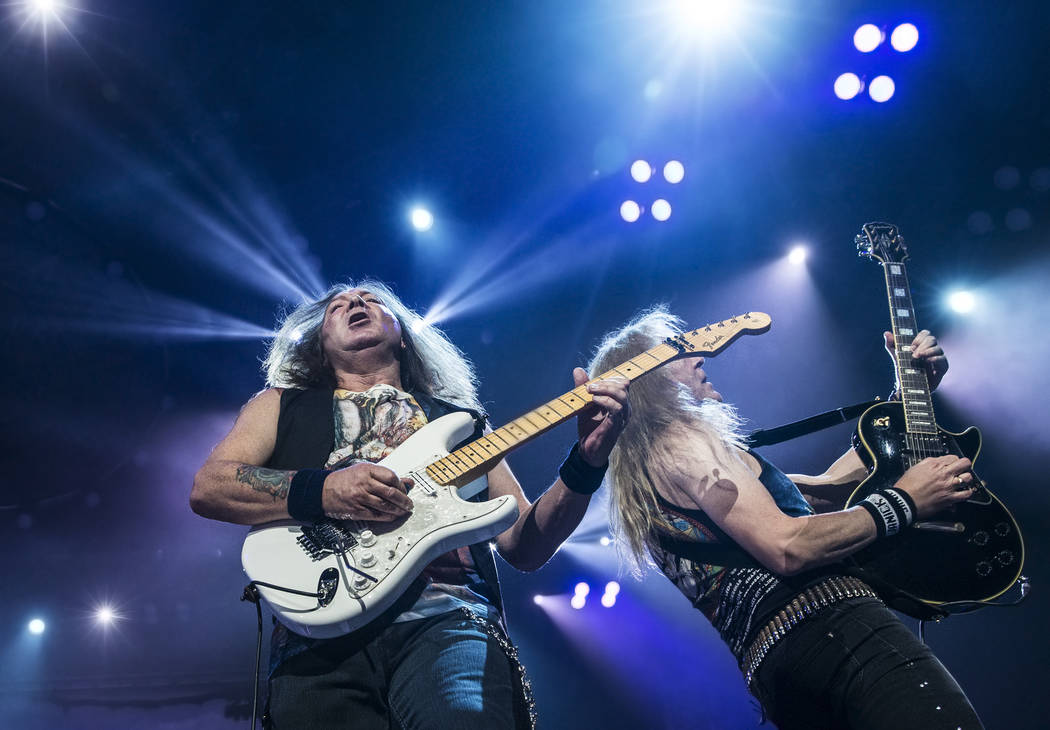 Iron Maiden guitarist Dave Murray, left, performs on Monday, July 3, 2017, at T-Mobile Arena, in Las Vegas. Benjamin Hager Las Vegas Review-Journal @benjaminhphoto