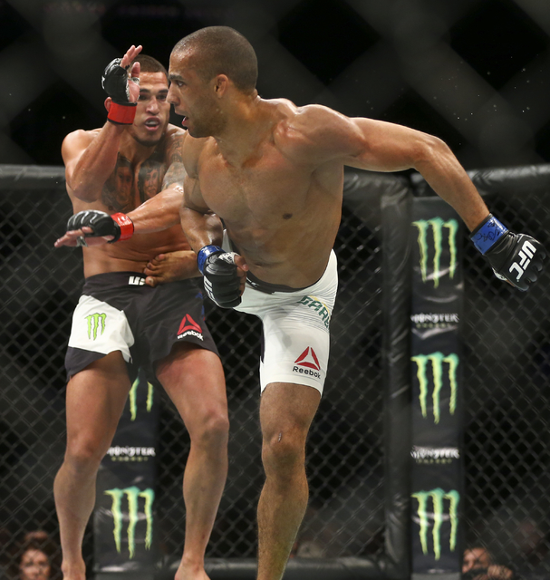 Edson Barboza, right, lands a kick against Anthony Pettis during a lightweight bout in UFC 197 at the MGM Grand Garden Arena in Las Vegas on Saturday, April 23, 2016. Barboza won by unanimous deci ...